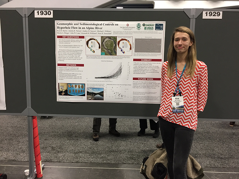 Kira Harris standing next to her research poster