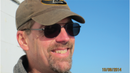 Jeff DeFreest wearing a hat and aviator sunglasses