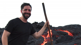 Lawrence Febo in front of a lava field with active flows