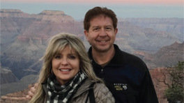 Jim Geitgey and his wife in front of the Grand Canyon