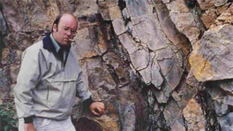 Ronald Nelson standing in front of an outcrop