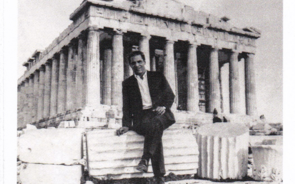 Thomas Anderson as a young man sitting on columns in front of the Parthenon in Greece