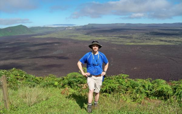 SES Alum Dan Kelley on the rim of the crater at the Sierra Negra Volcano; Isabela Island, Galapagos Islands