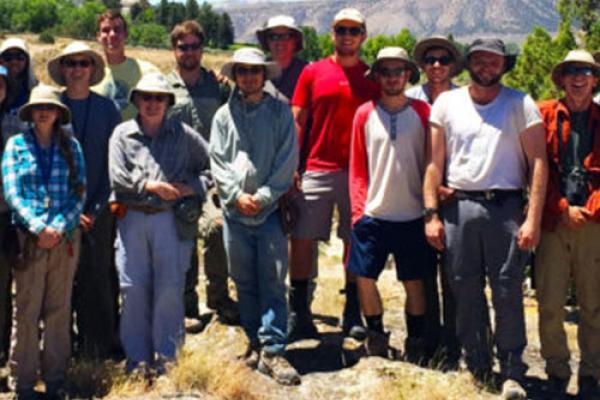 Geology majors and faculty gather behind Temple Hill during field camp.