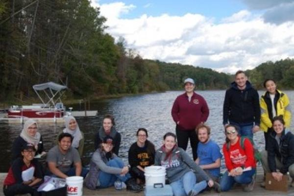 Geochemistry class poses at Lake Hope boat dock