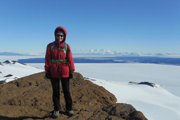 Earth Science student Elsa Saelens poses for a picture in frigid Antarctica