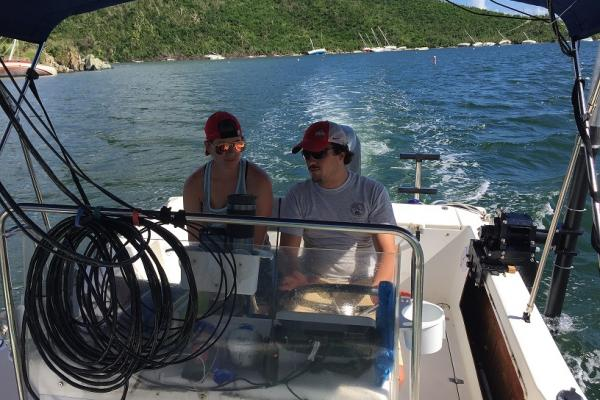 Ohio State graduate students Trevor Browning and Brandi Lenz survey coastal change following two hurricanes.