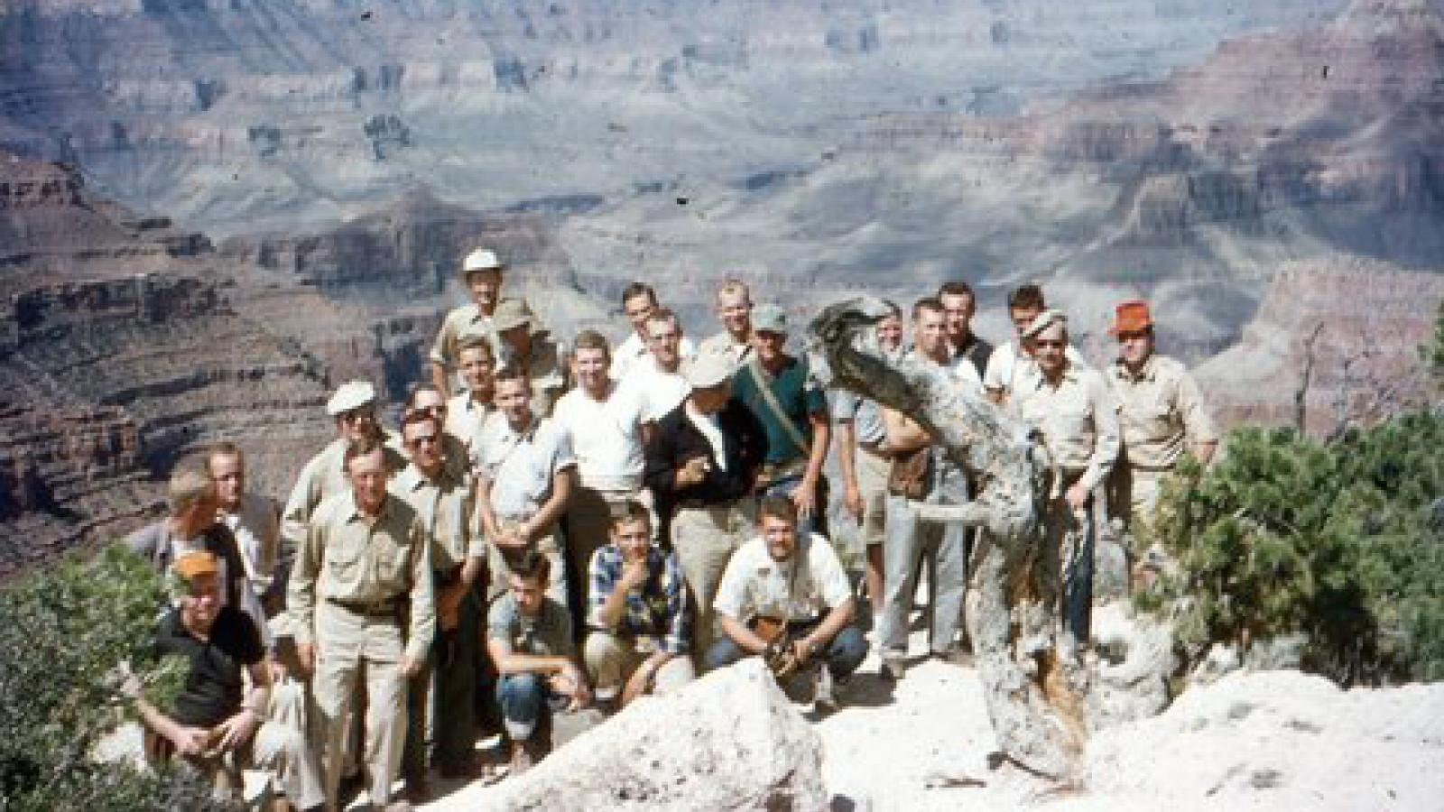 Field Camp group photo from 1955 overlooking a canyon
