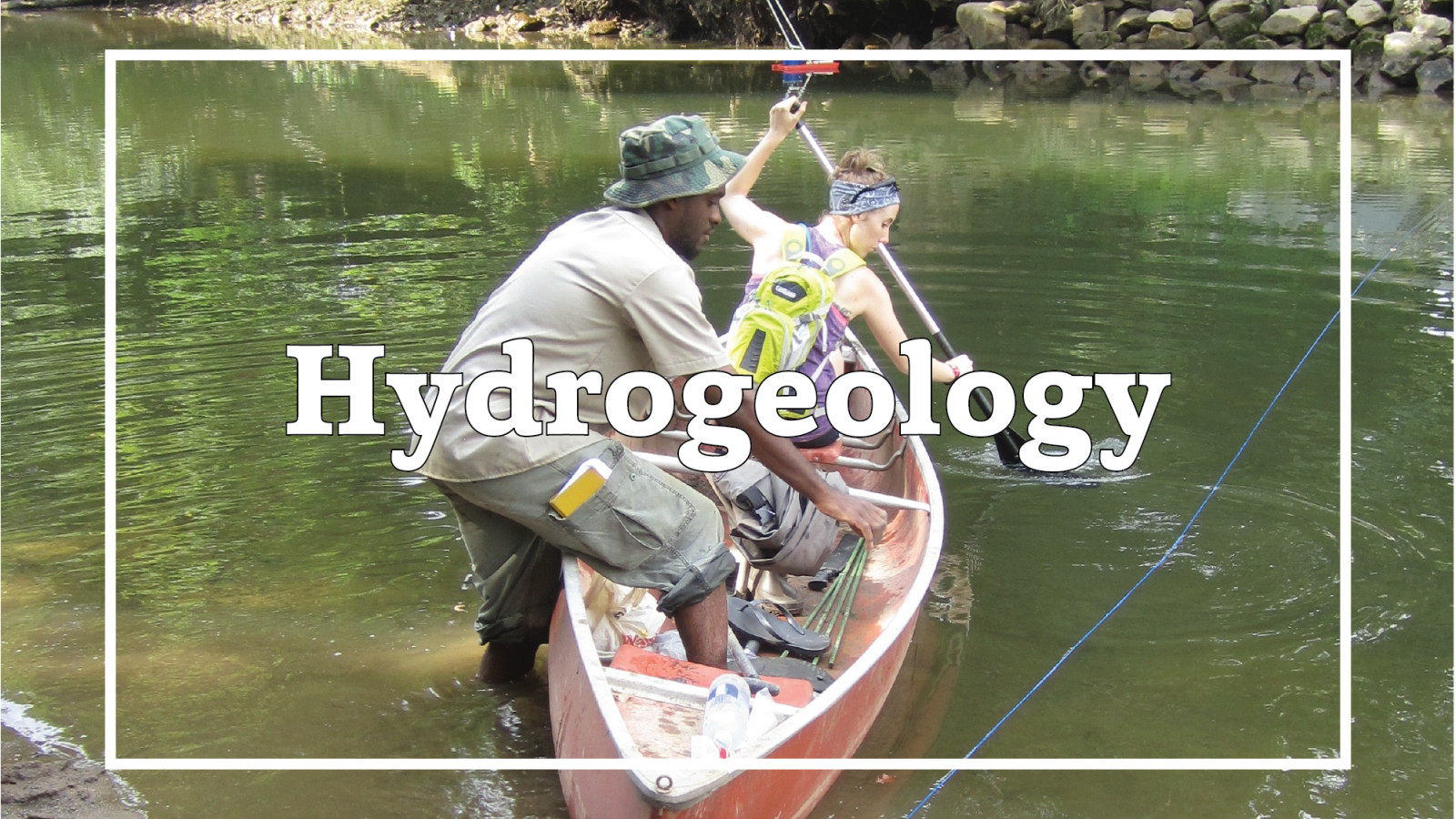 "Two students from SES work to collect river water samples from a canoe. Overlain text reads ""Hydrogeology""."