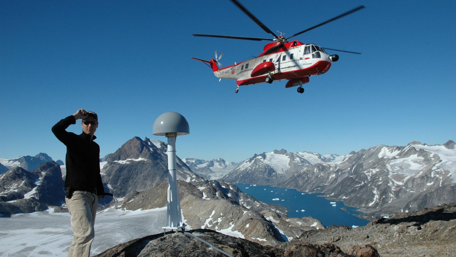 SES grad student Abel Brown waiting for a helicopter in greenland