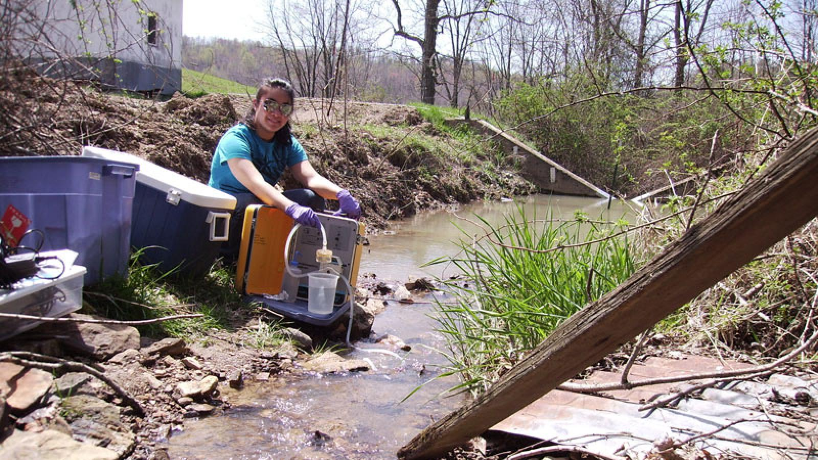 Student Teresa Huey water sampling in Cochocton, Ohio